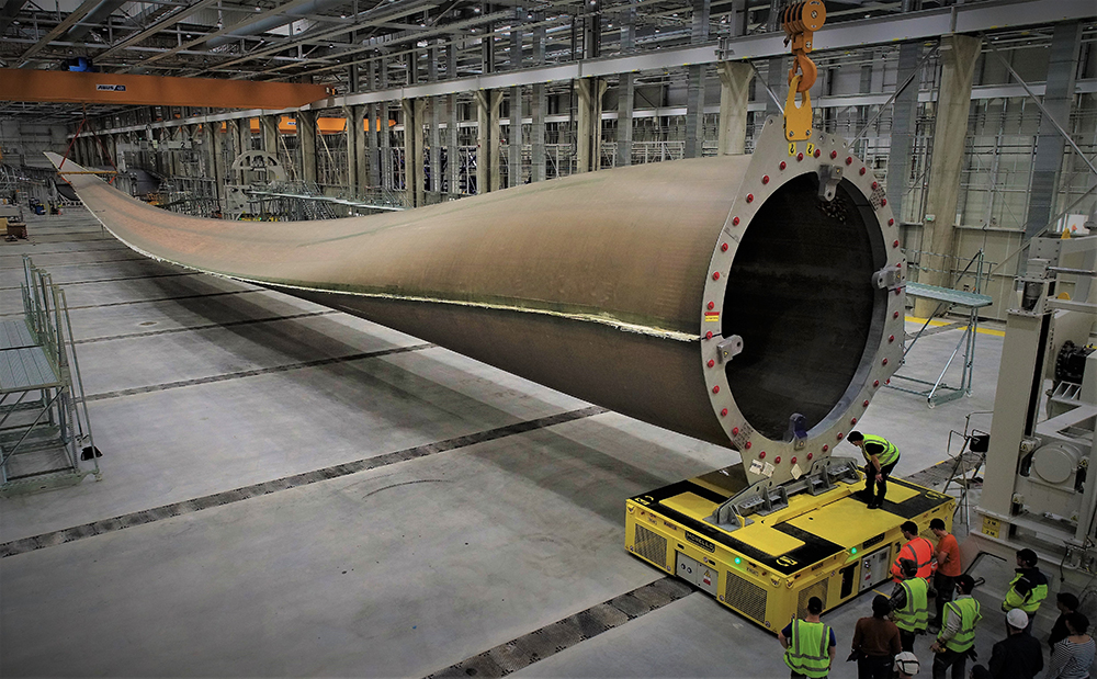 WORLD'S LARGEST WIND TURBINE BLADE IS LONGER THAN A FOOTBALL FIELD. HERE'S WHAT IT LOOKS LIKE